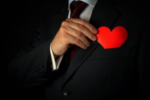 man-hiding-heart